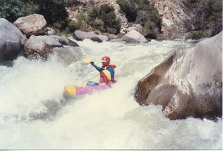 My old partner Art on Deadman's Curve, lower Kern River, CA An acient two tone Lynx I we used to call the clown boat